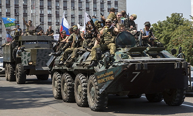 Pro-Russian rebels ride an APC and truck in eastern Ukraine.