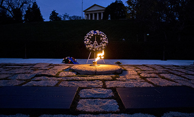 The eternal flame shines in the early morning light at the grave of John F. Kennedy at Arlington National Cemetery on Friday, Nov. 22, 2013, on the 50th anniversary of Kennedy's death.