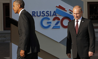 U.S. President Barack Obama, left, walks away after shaking hands with Russia's President Vladimir Putin during arrivals for the G-20 summit at the Konstantin Palace in St. Petersburg, Russia on Sept. 5, 2013.
