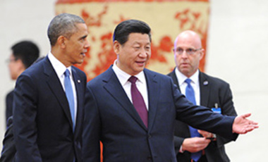 U. S. President Barack Obama is ushered by Chinese President Xi Jinping during a welcome ceremony at the Great Hall of the People in Beijing, China on Nov. 12, 2014. US and China agreed to take an action against climate change will cooperate military and