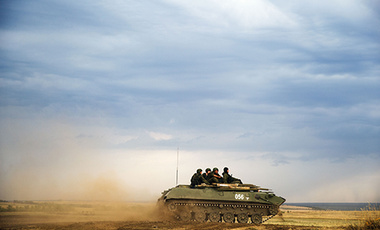 A Russian APC moves in a field in about 10 kilometers (6.2 miles) from the Russia-Ukrainian border.