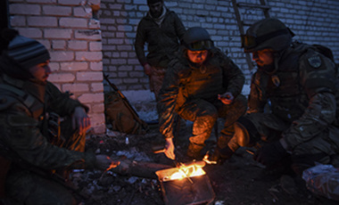 Fighters of the Azov Battalion cook food during a break in the town of Shyrokyne, eastern Ukraine, Sunday, March 22, 2015. Government and Russian-backed separatist forces face off against one another across an unseen line cutting through the town.