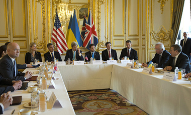 U.S. Secretary of State John Kerry, centre, hosts the Budapest Memorandum Ministerial meeting with Ukrainian Foreign Minister Andrii Deshchytsia, right, and British Foreign Secretary William Hague, left, in Paris, Wednesday, March 5, 2014.