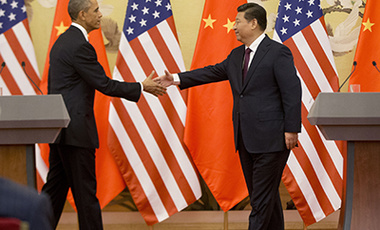 U.S. President Barack Obama, left, and Chinese President Xi Jinping, right, shake hands following the conclusion of their joint news conference at the Great Hall of the People in Beijing, Wednesday, Nov. 12, 2014.