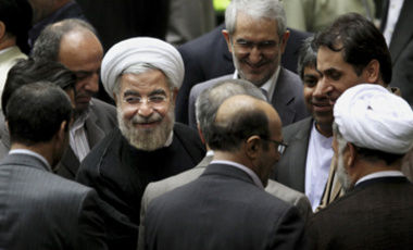 Iranian President Hasan Rouhani, center left with white turban, leaves at the conclusion of a session of the parliament to debate on his proposed Cabinet in Tehran, Iran, Tuesday, Aug. 13, 2013.