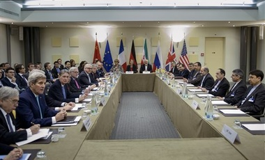 Officials from Britain, China, France, Germany, Russia, the U.S. and others wait for the start of a meeting on Iran's nuclear program on Tuesday, March 31, 2015