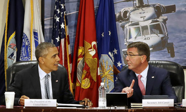 President Barack Obama speaks with Defense Secretary Ash Carter at the start of a National Security Council Meeting on the counter-Islamic State group campaign, Thursday, Aug. 4, 2016
