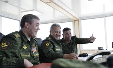 Russian Defense Minister Sergei Shoigu, head of General Staff, and head of the main directorate of combat training head an operation during military drills in Crimea, Friday, Sept. 9, 2016