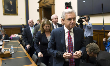 Wells Fargo CEO John Stumpf leaves a hearing room on Capitol Hill in Washington, September 29, 2016