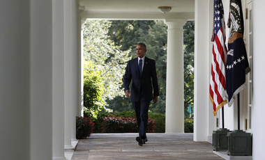 President Barack Obama walks from the Oval Office to the Rose Garden of the White House in Washington, Wednesday, Oct. 5, 2016