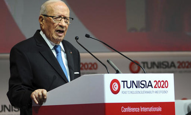 "Tunisian President Beji Caid Essebsi, left, delivers his speech during the opening ceremony of ""Tunisia 2020"", an international investment conference, in Tunis, Tunisia, Tuesday, Nov. 29, 2016."