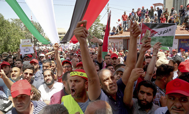 Jordanian protesters shout slogans during a demonstration outside the in front of the Labour Union office, in Amman, Jordan, Wednesday, June 6, 2018. (AP Photo/Raad al-Adayleh)