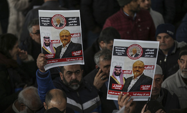 The members of Arab-Turkish Media Association and friends hold posters as they attend funeral prayers in absentia for Saudi writer Jamal Khashoggi in Istanbul, Turkey. (AP Photo/Emrah Gurel)