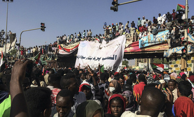 Sudanese demonstrators gather outside the army headquarters in the Sudanese capital Khartoum on Saturday, April 13, 2019.