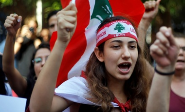 Protester chant slogans during ongoing protests against the Lebanese government, in front of the central bank, in Beirut, Lebanon, Monday, Oct. 28, 2019.