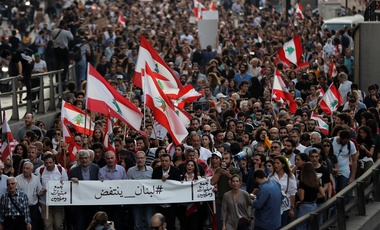 Anti-government protesters march during a protest against the central bank and the Lebanese government, in Beirut, Lebanon, Thursday, Oct. 31, 2019.