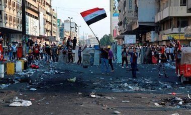 Protesters gather during the clashes between Iraqi security forces and anti-government demonstrators, in downtown Baghdad, Iraq, Tuesday, Nov. 12, 2019.