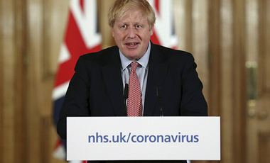 Britain's Prime Minister Boris Johnson holds a news conference giving the government's response to the new COVID-19 coronavirus outbreak, at Downing Street in London, Thursday March 12, 2020.