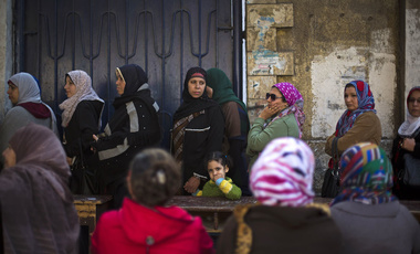 Egyptian women line up to vote in the country's constitutional referendum in Cairo, Egypt. (AP Photo/Khalil Hamra)