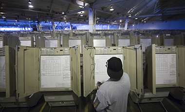A technician works to prepare voting machines to be used in the upcoming presidenial election, in Philadelphia, Oct. 14, 2016.