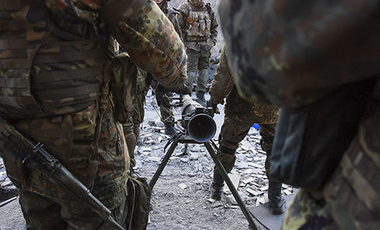 Fighters of the Azov Battalion prepare to fire an anti-tank weapon in eastern Ukraine. Government and Russian-backed separatist forces face off against one another, taken Sunday, March 23, 2015.