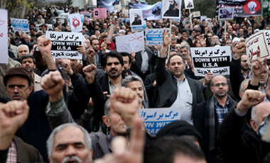 Iranian worshippers attend a rally to protest the execution of Sheikh Nimr al-Nimr, a prominent opposition Saudi Shiite cleric, after their Friday prayers in Tehran, Iran, Friday, Jan. 8, 2016.