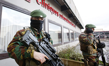 Belgian army soldiers guard a hospital in Woluwe nears Brussels, Belgium.