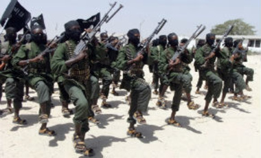 In this Thursday, Feb. 17, 2011 file photo, hundreds of newly trained al-Shabaab fighters perform military exercises in the Lafofe area 18 km south of Mogadishu, Somalia.