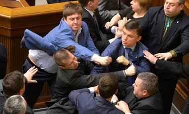 Communist lawmakers scuffle with right-wing Svoboda (Freedom) Party lawmakers during a parliament session of Verkhovna Rada, the Ukrainian parliament, in Kiev, Ukraine Tuesday, April 8, 2014.