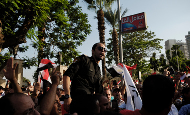 Cairo, Egypt - June 30, 2013: Unidentified police man shouts slogans against the President Muhammad Morsi in a rally in el-Tahrir street