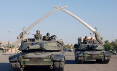 "M1A1 Abrams under the ""Hands of Victory"" in Ceremony Square, Baghdad, Iraq."