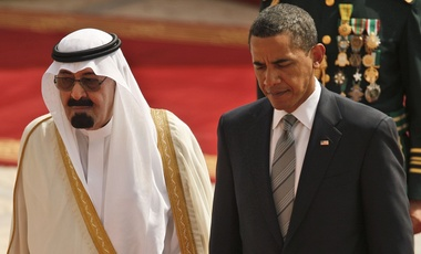 President Barack Obama, left, walks with King Abdullah of Saudi Arabia