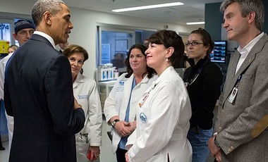 President Barack Obama talks with staff at Massachusetts General Hospital in Boston, Massachusetts on 18 April 2013