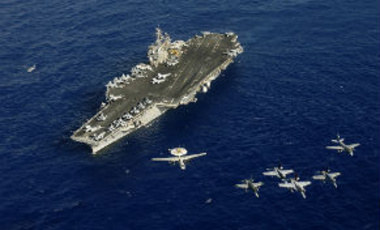 Aircraft assigned to Carrier Air Wing (CVW) 5 fly in formation above the aircraft carrier USS Kitty Hawk (CV 63), Pacific Ocean, June 23, 2008.