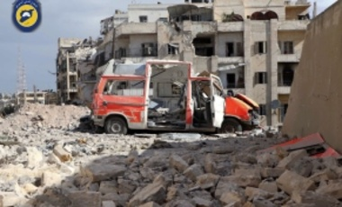 In this photo provided by the Syrian Civil Defense group known as the White Helmets, a destroyed ambulance is seen outside the Syrian Civil Defense main center after airstrikes in Ansari neighborhood in the rebel-held part of eastern Aleppo, Syria, Friday