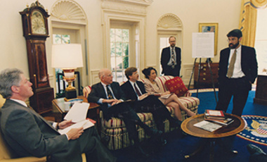 Matthew Bunn (standing, left) and John P. Holdren (right) brief President William Clinton in May 1995 on nuclear security in Russia.