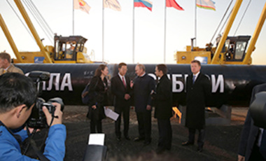 Russian and Chinese state representatives stand before the ceremonial ground-breaking of the Power of Siberia gas pipeline in Yakutsk, Russia, September 1, 2014.