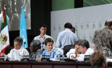 Leadership of the United Nations Framework Convention on Climate Change prepare to announce the Cancun Agreements at the COP16 CMP6 Climate Change Conference in Cancún, Mexico.