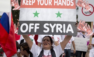 Protesters against U.S. military action in Syria shout during a demonstration in front of the White House in Washington, September 9, 2013.