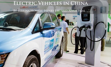 A visitor looks at an e6 electric taxi of BYD during the 11th China International Battery, Raw Material, Producing Equipment and Battery Parts Fair, also known as Battery China 2013, in Beijing, China, 17 June 2013.