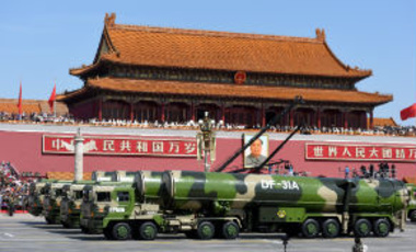 Military vehicles carrying DF-31A intercontinental ballistic missiles (ICBM) march past the Tiananmen Rostrum during a military parade, September 3, 2015.