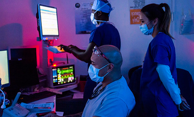 Staff assigned to Naval Medical Center San Diego's Radiology Department monitor a patient during a brain MRI, Aug. 12, 2020.