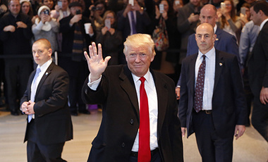 President-elect Donald Trump waves to the crowd as he leaves the New York Times building following a meeting, Tuesday, Nov. 22, 2016, in New York.