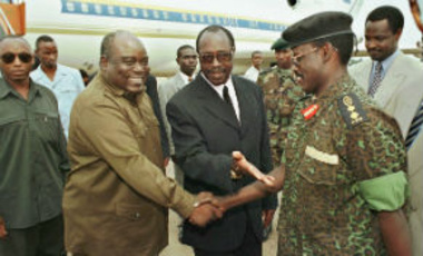Laurent Kabila, President of the Democratic Republic of Congo, with Rwandan President Pasteur Bizimungu, center, shakes hands with Rwandan Military Chief of Staff Sam Kaka in Kigali, Monday, September 8, 1997.