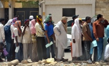 Foreign illegal laborers wait in a long queue outside the Saudi immigration offices at the Al-Isha quarter of the Al-Khazan district, west of Riyadh.