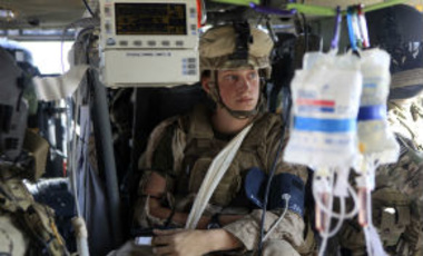 Cpl. Brewer Gerald of 3/6 Kilo Company 2nd Marine Regiment, who was wounded by a roadside bomb, on board a medevac helicopter in southern Afghanistan, Sept. 2, 2011.