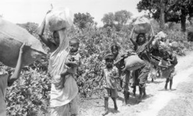 East Pakistanis, fleeing from their homes to seek safety in India, as they pass through the provisional capital of Chuadanga April 16, 1971.