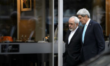 U.S. Secretary of State John Kerry, right, speaks with Iranian Foreign Minister Mohammad Javad Zarif, in Geneva, Switzerland, Wednesday, January 14, 2015, during a bilateral meeting ahead of nuclear negotiations.