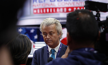Dutch lawmaker Geert Wilders talks to reporters as he arrives at at Quicken Loans Arena before the start of the second day session of the Republican National Convention in Cleveland, Tuesday, July 19, 2016.