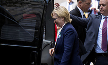 Democratic presidential candidate Hillary Clinton walks from her daughter Chelsea's apartment building Sunday, Sept. 11, 2016, in New York.